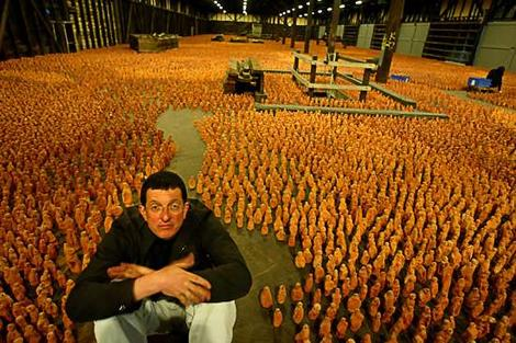 Antony Gormley with his 'Asian Field' made over five days in collaboration with 300 villagers in Xianxian in China